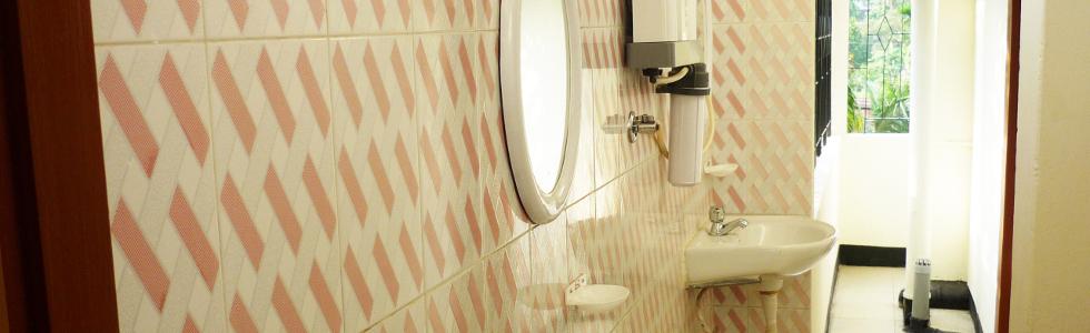 Basin, aquaguard and wall tiles side view in Pretty Girls Hostel, Guwahati